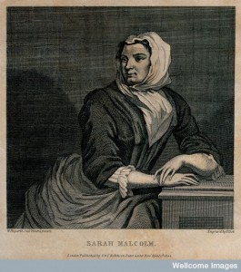 V0041240 Sarah Malcolm sitting in prison with her hands resting on a