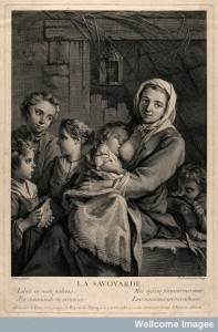 V0015029 A poor woman in a dingy attic, surrounded by her children, o