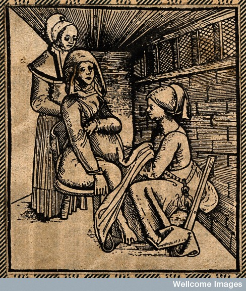 A woman seated on a obstetrical chair giving birth aided by a midwife who works beneath her skirts.
